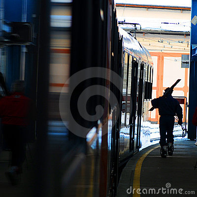 Skier on railway platform