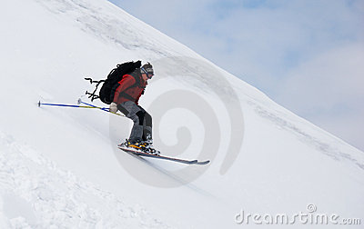 Skier running down