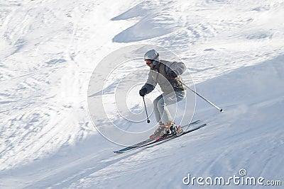 Skier with ski pole on snow