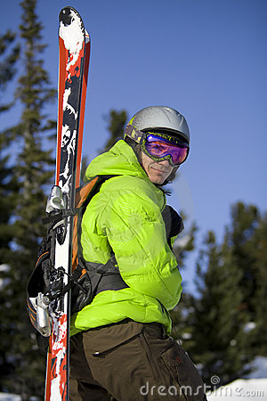 Skier with skis on the back