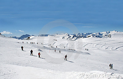 Skiers on Alpine ski slope
