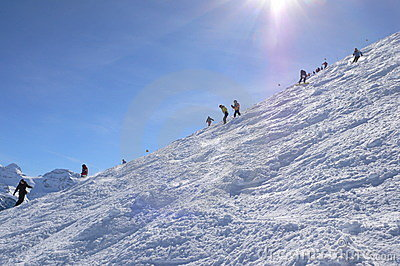 Skiers on Cubere run