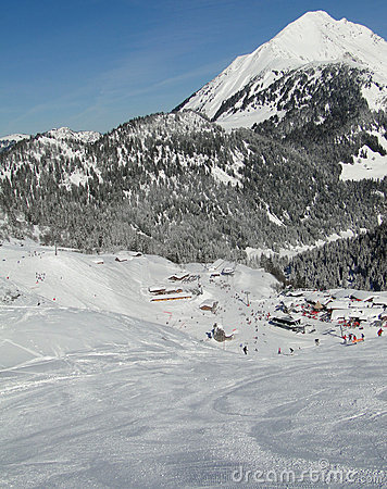 Skiers descend to tiny mountain village