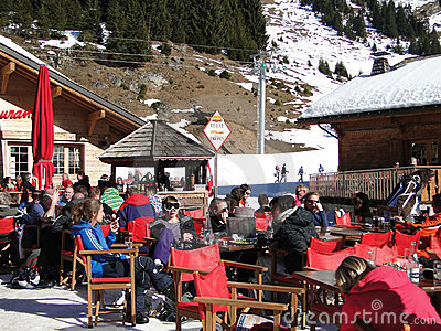 Skiers enjoy their lunch on a sunny day Editorial Stock Photo