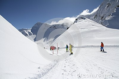 Skiers going down the slope at ski resort