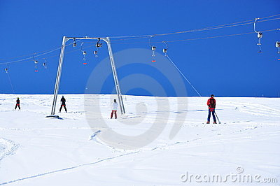 Skiers going up
