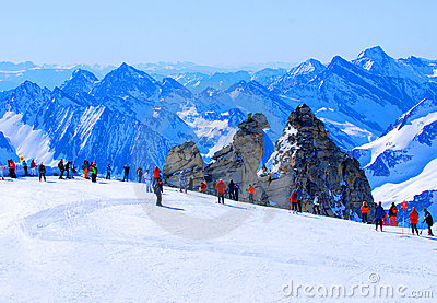 Skiers on high mountain slope
