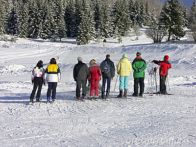 Skiers and instructor