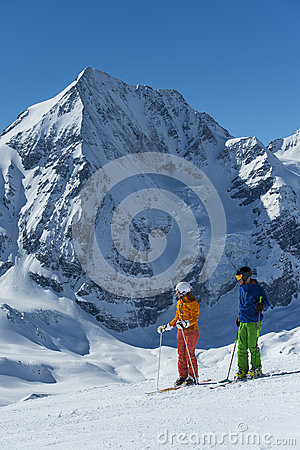 Free Skiers Makes A Break And Enjoy The View Stock Photography - 65881962