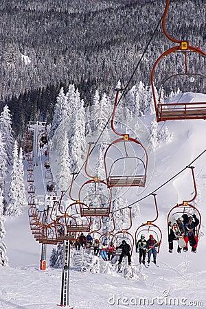 Free Skiers Riding The Ski-lift Royalty Free Stock Image - 5795366