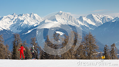 Skiers on a Ski Run in the Alps