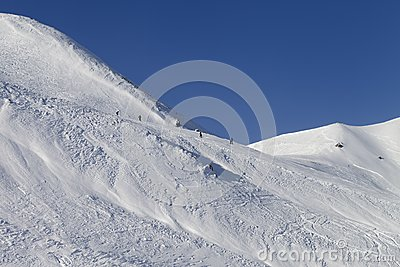 Skiers and snowboarders on ski piste