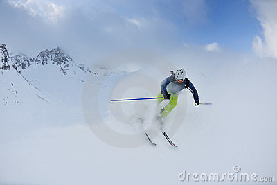 Skiing on fresh snow at winter season