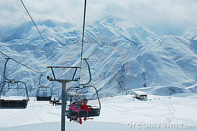 Skiing lift with people