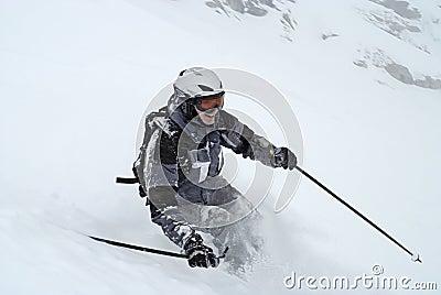 Skiing (Man in grey ski suit)