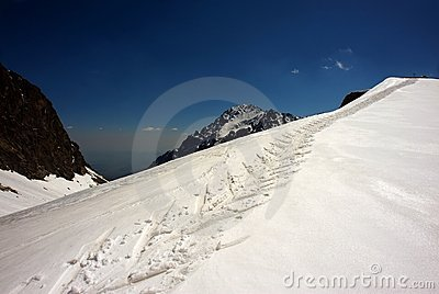Skiing path in winter mountains