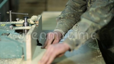 Skilled carpenter working on wood milling machine stock video