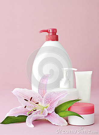Skin care products on pink
