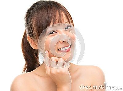 Skin care woman putting face cream