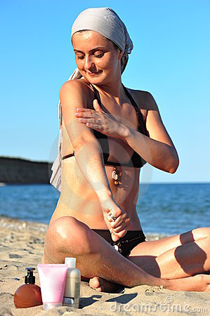 Skin health: woman applying sun block