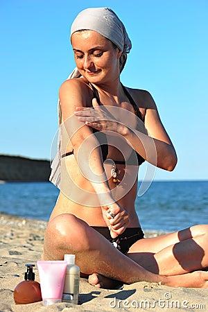 Skin health: woman applying sun block