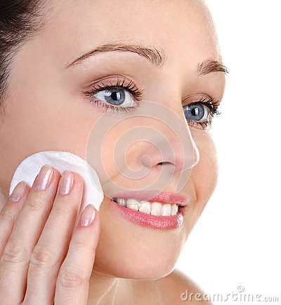 Skincare attractive girl applying face pack
