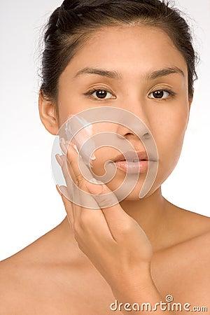 Skincare girl put moisturizer
