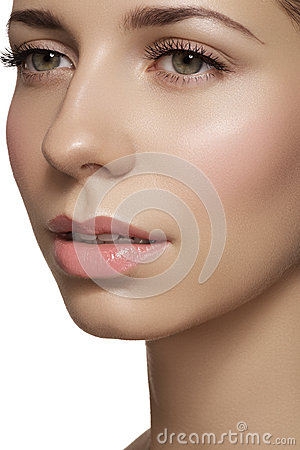 Skincare & make-up. Woman face with clean shiny skin & fresh rouge
