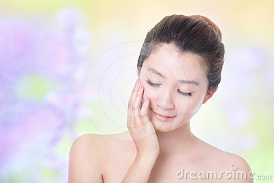 Skincare woman close eyes with flower background