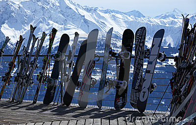 Skis and snowboards in winter resort Editorial Stock Image