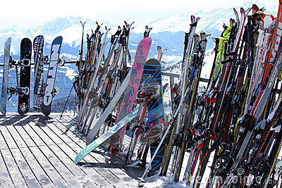 Skis and snowboards in winter resort Editorial Photo