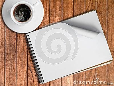 Skissa boken och den vita koppen av varmt kaffe