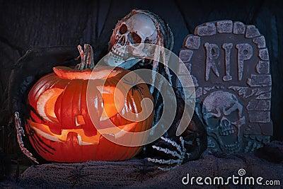 Skull monster and halloween pumpkin