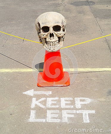 Skull road hazard marker keep left