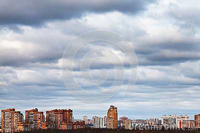 Sky with blue clouds over urban houses
