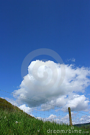 The Sky,Clouds and Barbed Wire Barrier