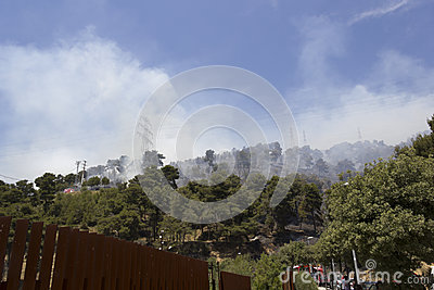 The sky is filled with smoke from the fire Editorial Stock Photo