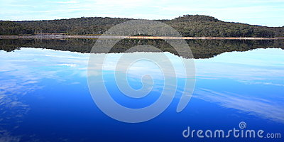 Lake reflecting australian landscape