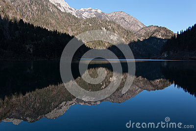 Sky and mountain reflect in the lake