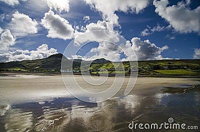 sky reflected on the beach