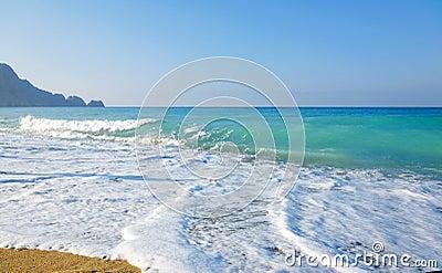 Sky, sea, waves and sandy beach.