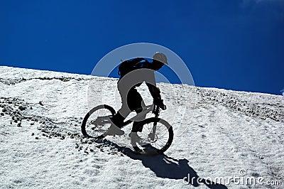 Sky, snow and mountain biker