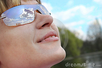 Sky in woman sunglasses