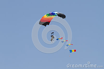 Skydiver with Romanian Flag through clouds Editorial Photo