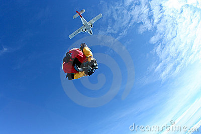 Skydiving instructor guiding first timer