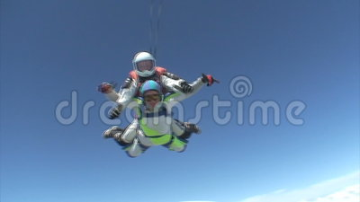 Skydiving video. Instructor and student skydivers perform a tandem jump
