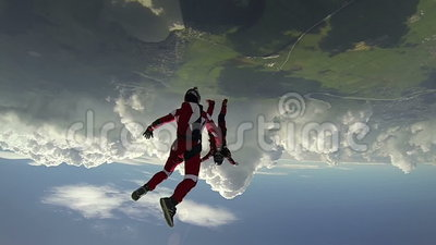 Skydiving video. Two sports figures perform parachutist in free fall