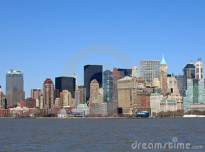 Skyline of buildings in New York against blue sky.