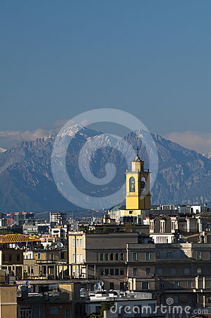Skyline of Milan with Alps