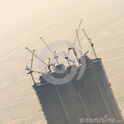 Free Skyscraper Construction Site With Cranes On Top Of Buildings. Royalty Free Stock Photos - 85018758